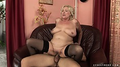Chubby, busty blonde granny rides on his rod and gives more head