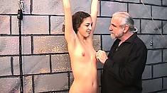 Petite teenage slave gets her tiny nipples clamped and teased