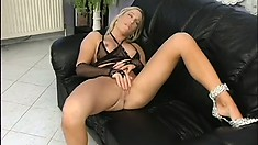 Seductive blonde tart in see-through lingerie rubs her pussy