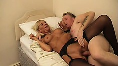 Nasty blonde granny sits on his face and sucks his cock in a hot 69er