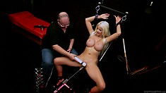 Horny, busty blonde rides a fuck machine and gets clit vibrated