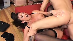 Buxom Asian cougar in sexy black lingerie has a long cock invading her fiery holes