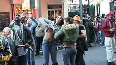 Admirable girls are flashing their sweet titties on the crowded street
