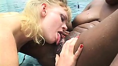 Hayley Rivers enjoys wild lesbian sex with a black hottie in the pool