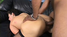 Busty brunette mom in stockings finds intense pleasure in a black cock