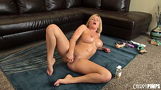 Sexy blonde Krissy licks off her pussy juice and keeps on toying