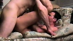 Lying on the couch, the horny dude lifts his legs to enjoy the rough anal fucking